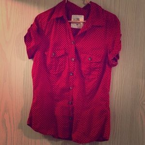 Red button up shirt with white polka dots